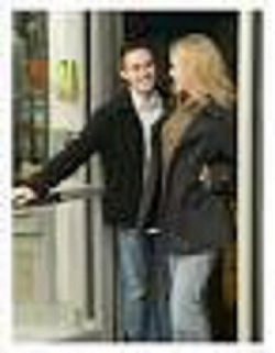 man holding a door for a woman